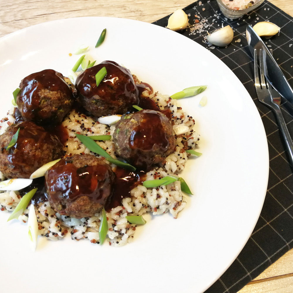 Veal meatballs with teriaki sauce and pearl rice with quinoa
