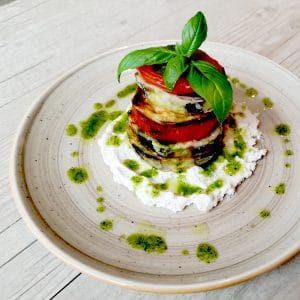 Aubergine in tempura with Rukatka cream cheese, sauteed tomatoes and basil dressing